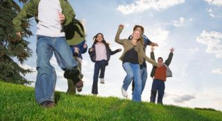 Groups of kids running and jumping down a hill.